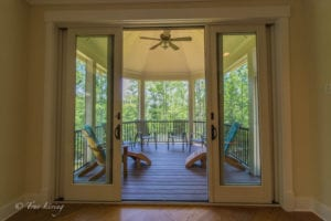 big glass doors opening to back porch