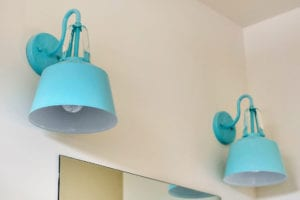 blue light fixtures in bathroom