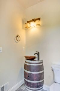 barrel sink in custom bathroom