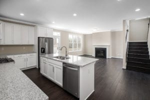 view of kitchen island and fireplace